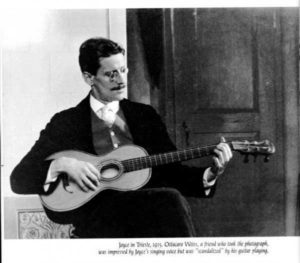James Joyce playing the guitar, 1915